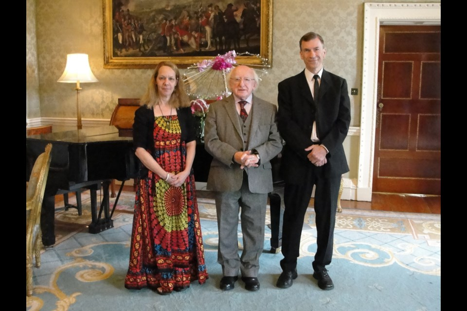 Linda DiCarlo, President of Ireland Michael Higgins and Professor Chris DiCarlo at the president's estate in Dublin. Supplied photo for GuelphToday.com