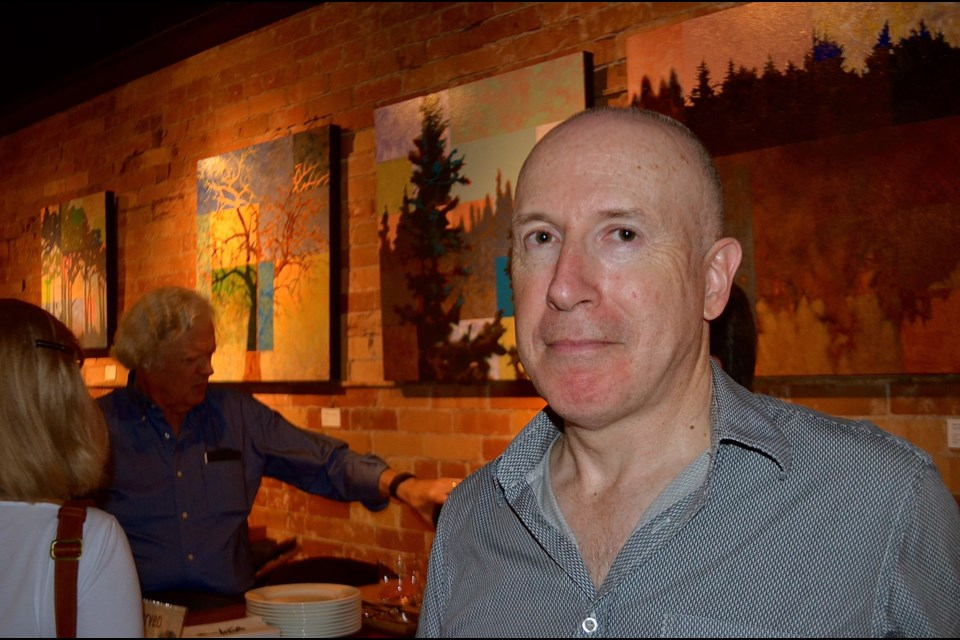 Artist Bob Young during the opening of the Tree Silhouettes exhibit Wednesday at Miijidaa Café & Bistro. Troy Bridgeman for GuelphToday.com
