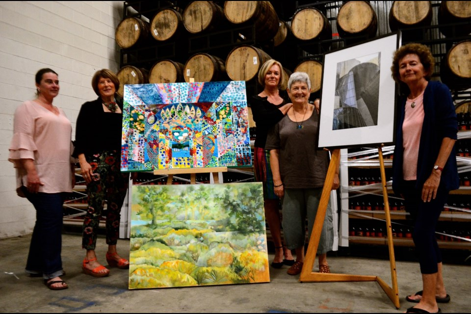 Sarah Dawkins, Sharyn Seibert, Joanne Poluch, Deborah Dryden and Annette Twist at the Wellington Brewery warehouse and site of the Art$Pay Now exhibit Sep 22 & 23.  Troy Bridgeman for GuelphToday.com
