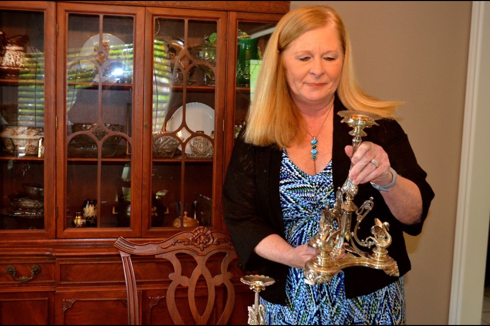 Wendy Smith examines a silver candelabra before taking it to an appraiser. Troy Bridgeman for GuelphToday.com