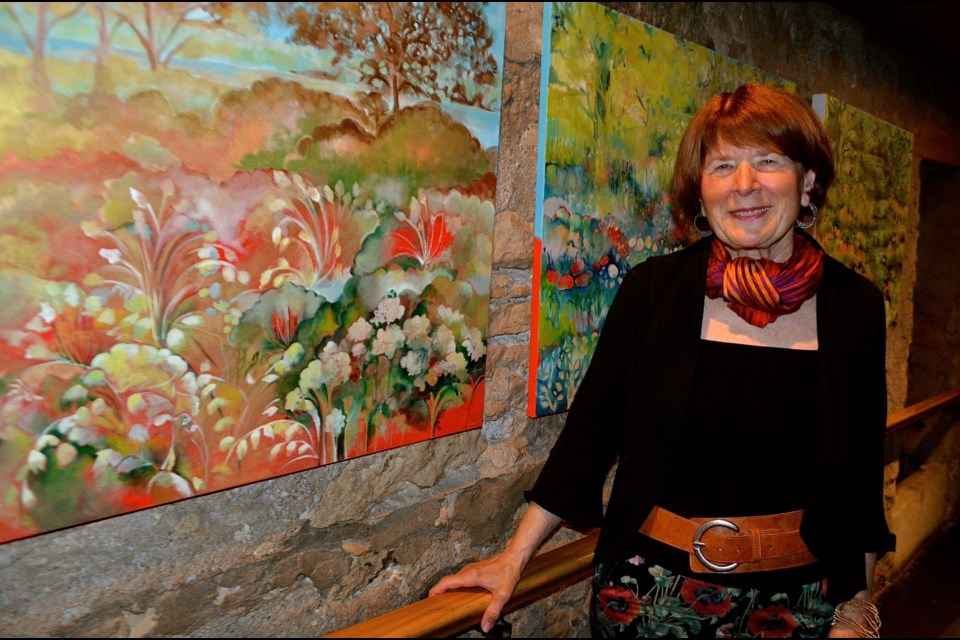 Artist and activist Sharyn Seibert with paintings inspired by the natural beauty of Ontario Reformatory lands on York Road.  Troy Bridgeman for GuelphToday.com