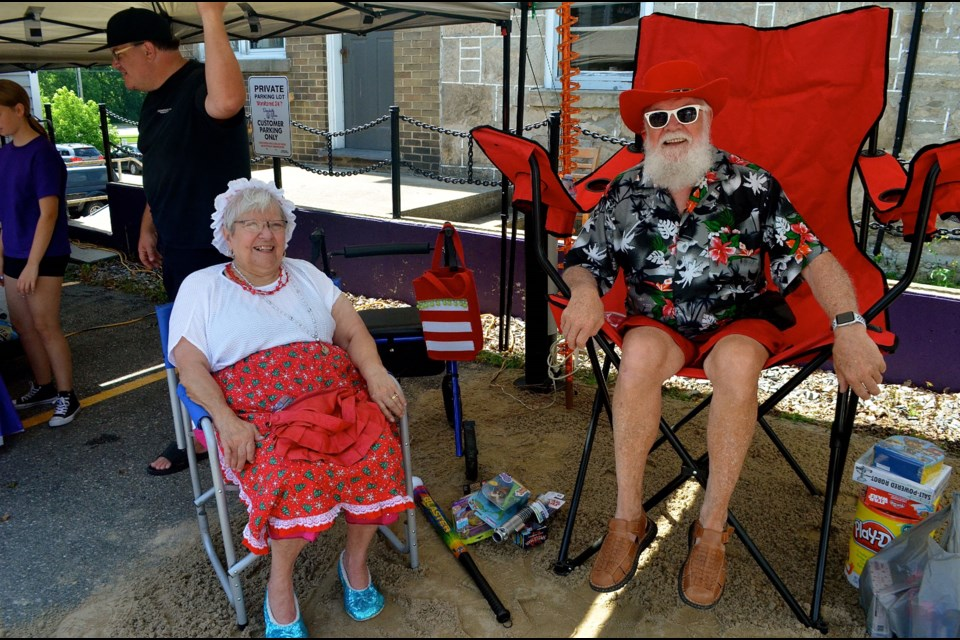 Santa and Mrs. Claus are keeping it cool in the shade during Christmas in July. Troy Bridgeman for GuelphToday.com