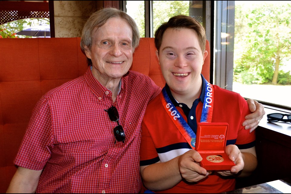 Special Olympian and sports radio host Taylor Redmond with his father Steve Redmond. Troy Bridgeman for GuelphToday.com