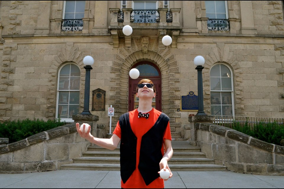 Teen magician and juggler Noah Nogueira has a lot of balls in the air outside old City Hall . Troy Bridgeman for GuelphToday.com