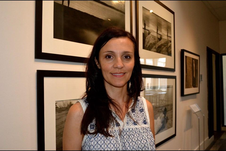 Artist Eleni Bakopoulos at the entrance of Gritt Gallery. Troy Bridgeman for GuelphToday.com