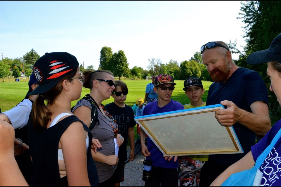 Alisha Arnold and kids from the River Walkers day camp present Jeremy Shute with a hand painted sign. Troy Bridgeman for GuelphToday.com