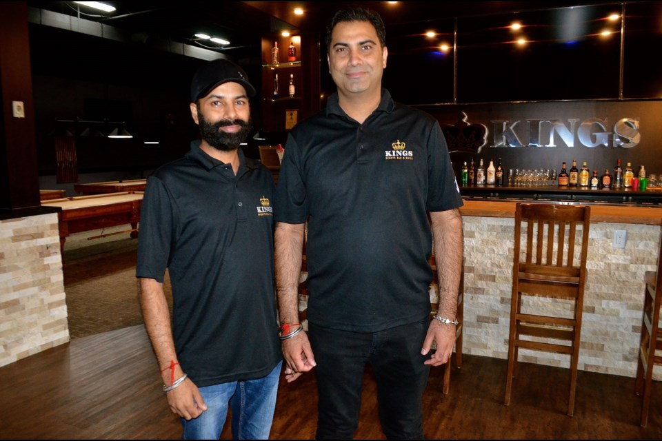 Gurdeep Singh and brother Davinder Singh inside the new Kings Sports Bar & Grill on Woodlawn Road. Troy Bridgeman for GuelphToday.com