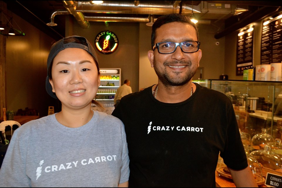 Crazy Carrot general manager Noriko Kato and owner Anurag Sood at their new restaurant on Wyndham Street.  Troy Bridgeman for GuelphToday.com