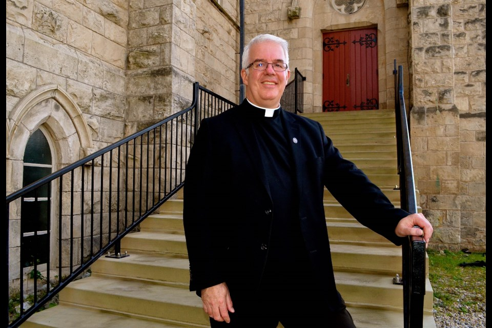 Pastor Ian Duffy on the steps of the north entrance of Basilica of Our Lady Immaculate. Troy Bridgeman for GuelphToday.com