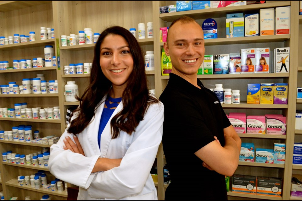 Founder of Pharmasea Justin Macorin with pharmacist Sarah Johnson at Willow Pharmacy. Troy Bridgeman for GuelphToday.com