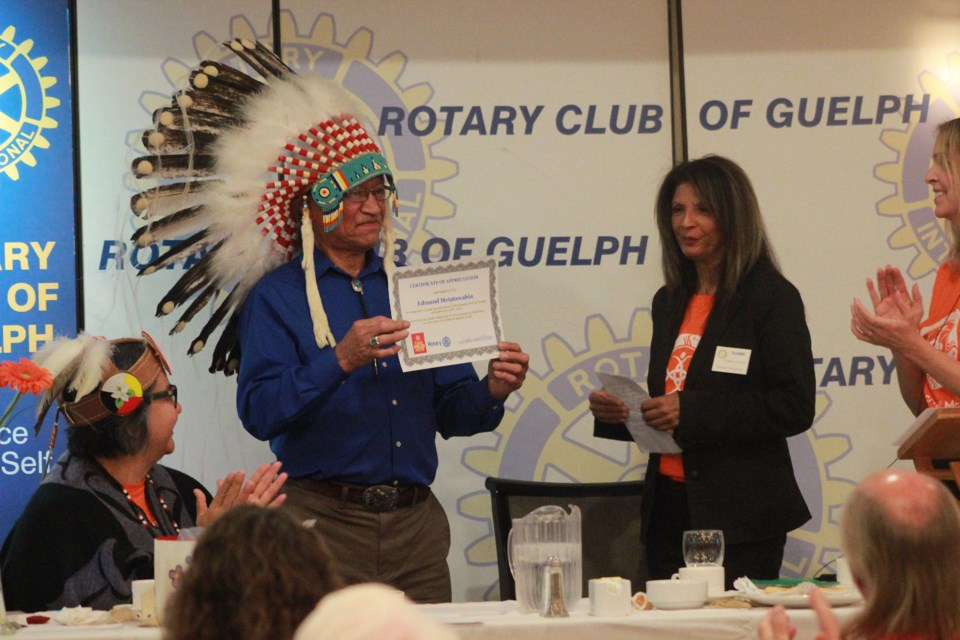 Indigenous author Edmund Metatawabin receives a certificate of appreciation. Anam Khan/GuelphToday