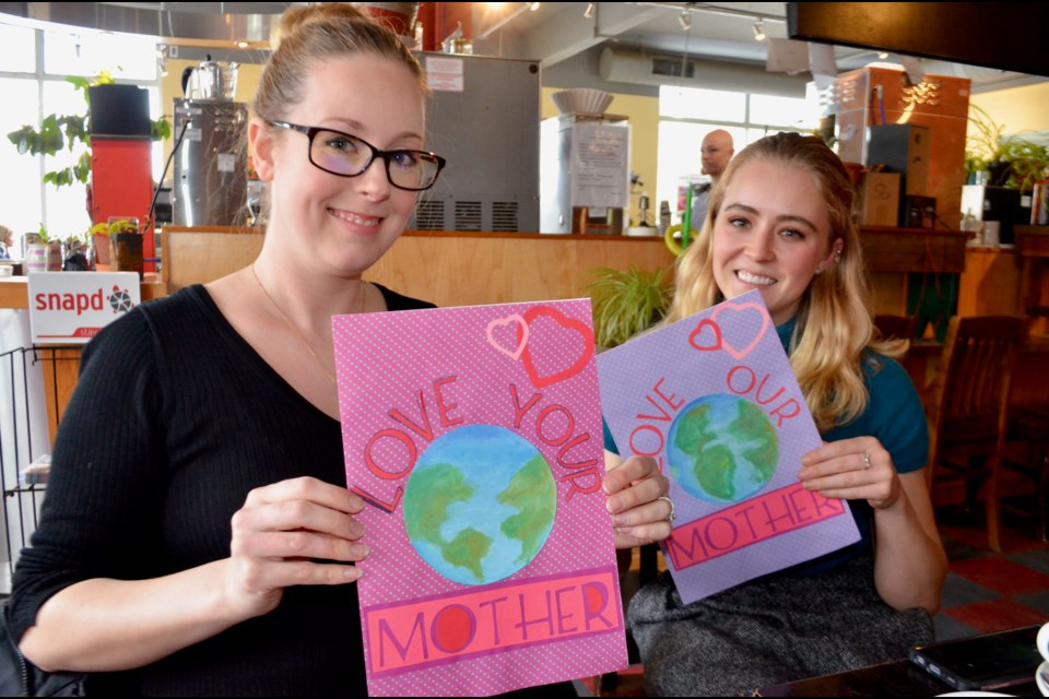 Meghan Lewis and MacKenzie Harris have prepared Valentines to present to banks for the Love Your Mother environmental campaign.  Troy Bridgeman/GuelphToday