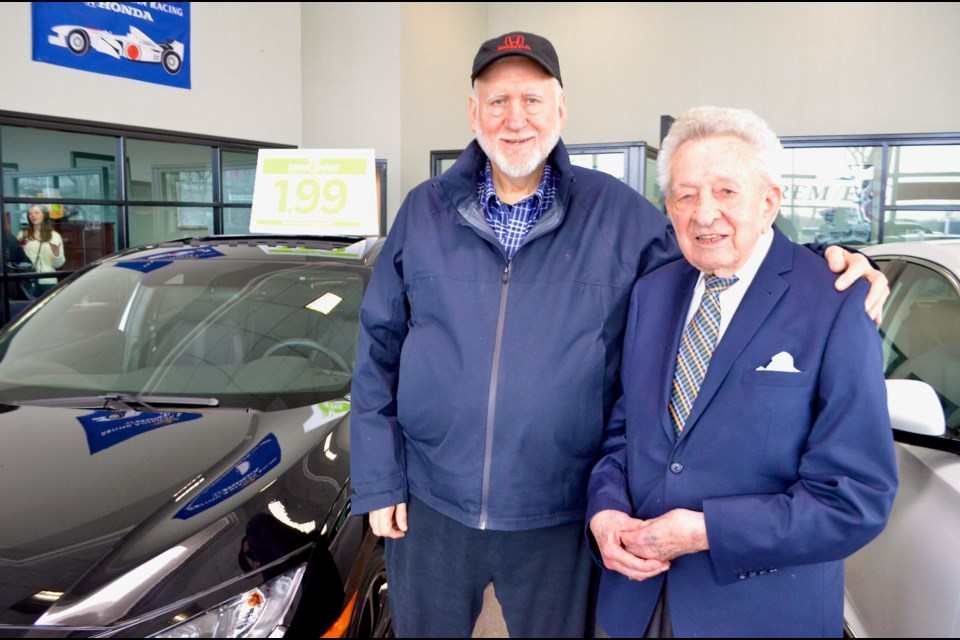 Gerry Kowalsky with the owner of Olympic Honda, David Brewis. Troy Bridgeman/GuelphToday