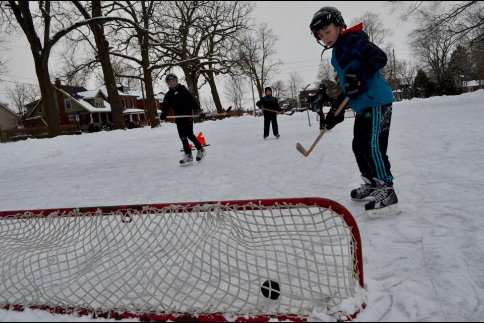 Neighbourhood kids play hockey at Sunny Acres rink. Troy Bridgeman/GuelphToday