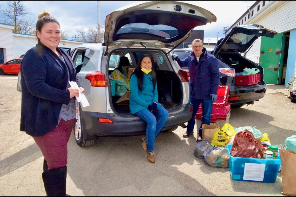 Guelph Food Bank administrator Pauline Cripps with Stronger Together food drive organizers Betsy Scott and Ed Clayson. Troy Bridgeman/GuelphToday