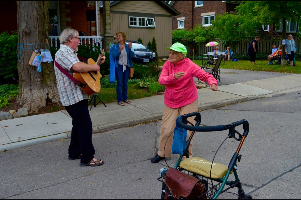 90-year-old Alice McNeish pushes her walker aside to dance during a performance by MacTalla Road featuring Bob MacLean and Carol Pines.  Troy Bridgeman/GuelphToday