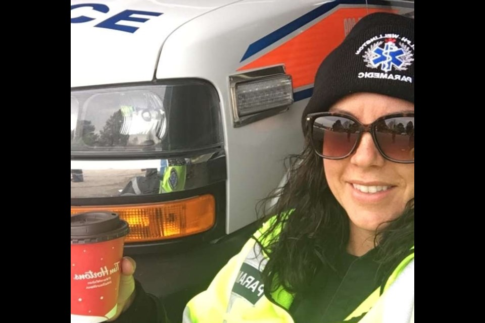 Paramedic Marsha Sealey sips coffee between calls at work. Sealey has been a part of the Guelph Wellington Paramedic Service for seven years. Supplied photo