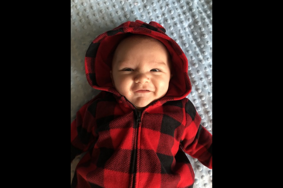 Baby Max Cameron is all smiles for the camera at home. Supplied photo