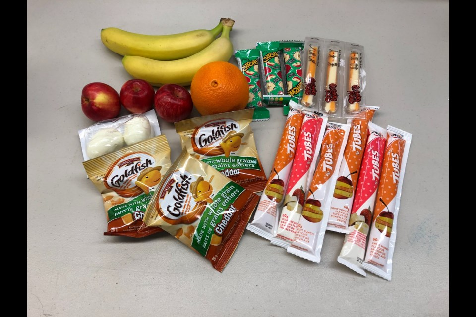 Kits delivered through the Food & Friends at Home program contain three food groups: protein, fruit and vegetables and grains. Supplied photo