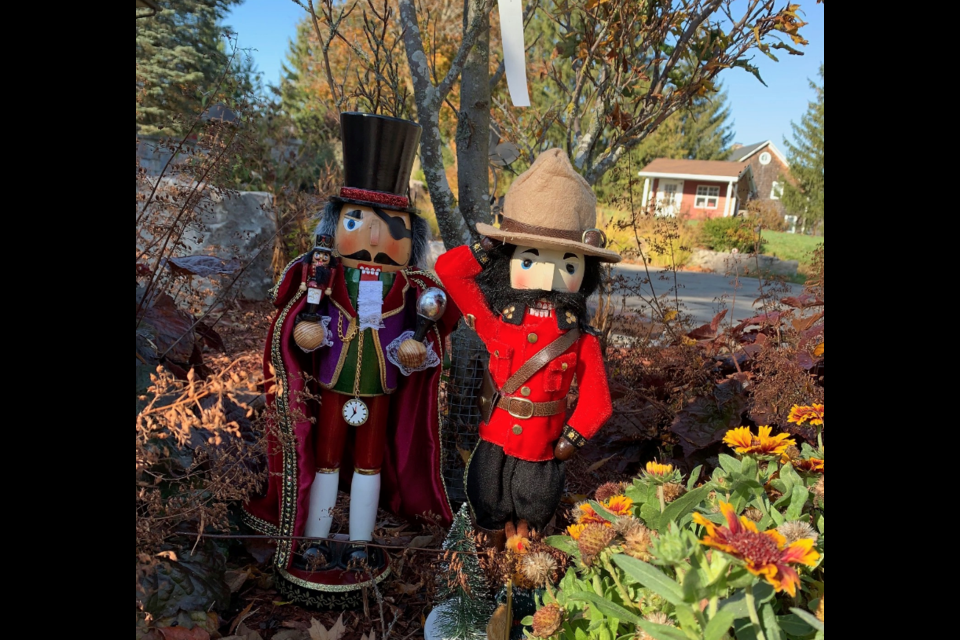 A close-up of Merlin and his bodyguard in a front garden. Supplied photo