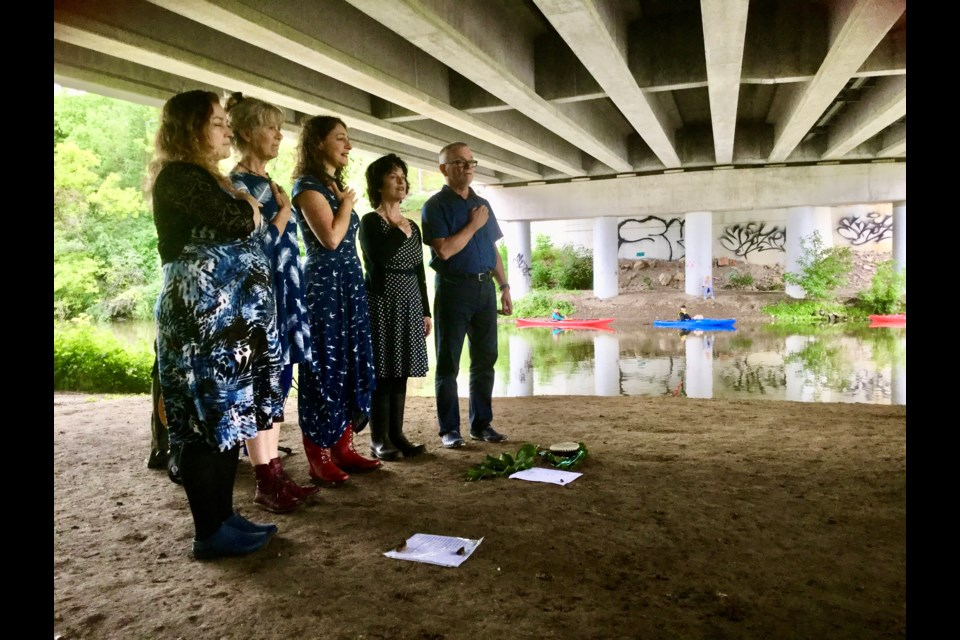 The Ondine Chorus, featuring Tricia Brubacher, Tannis Slimmon, Shannon Kingsbury, Sue Smith and Dave Beattie perform under the Victoria Road Bridge during the 2Rivers Festival in 2018.