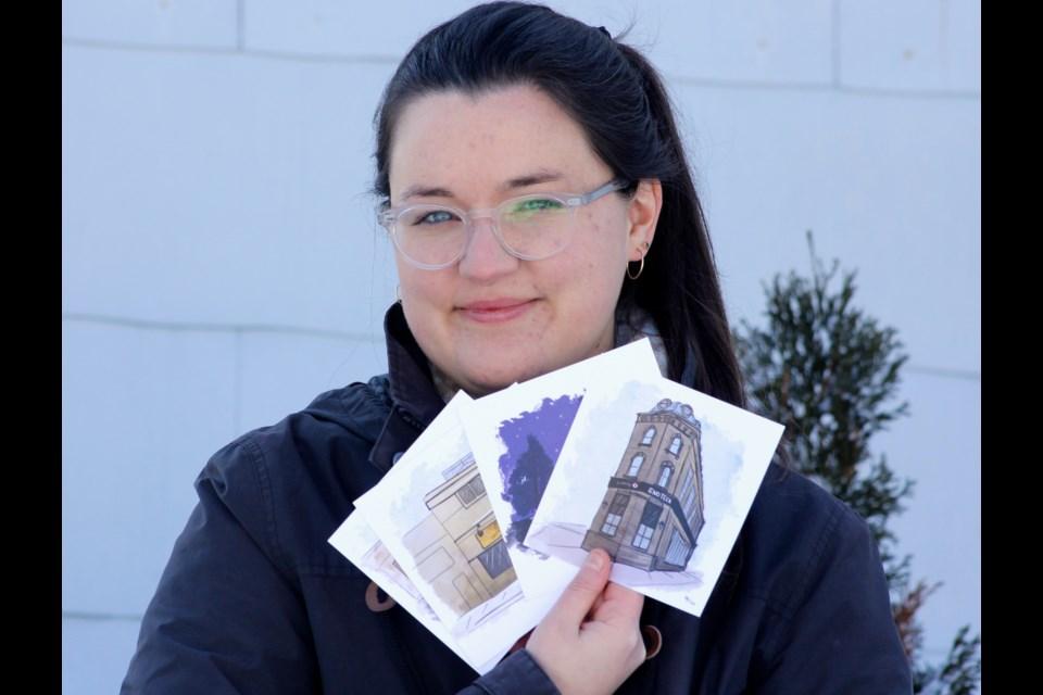 Ellen Piazza holds up her doodles. Anam Khan/GuelphToday