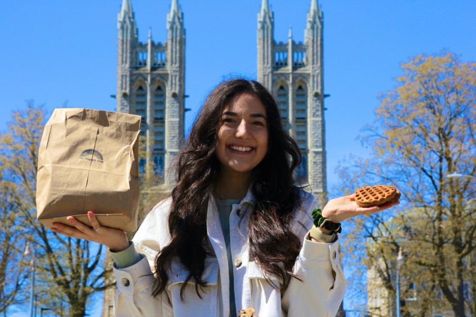 Domenique Mastronardi holds up a bag of waffles in Downtown Guelph, the place that helped her launch her business. Anam Khan/GuelphToday