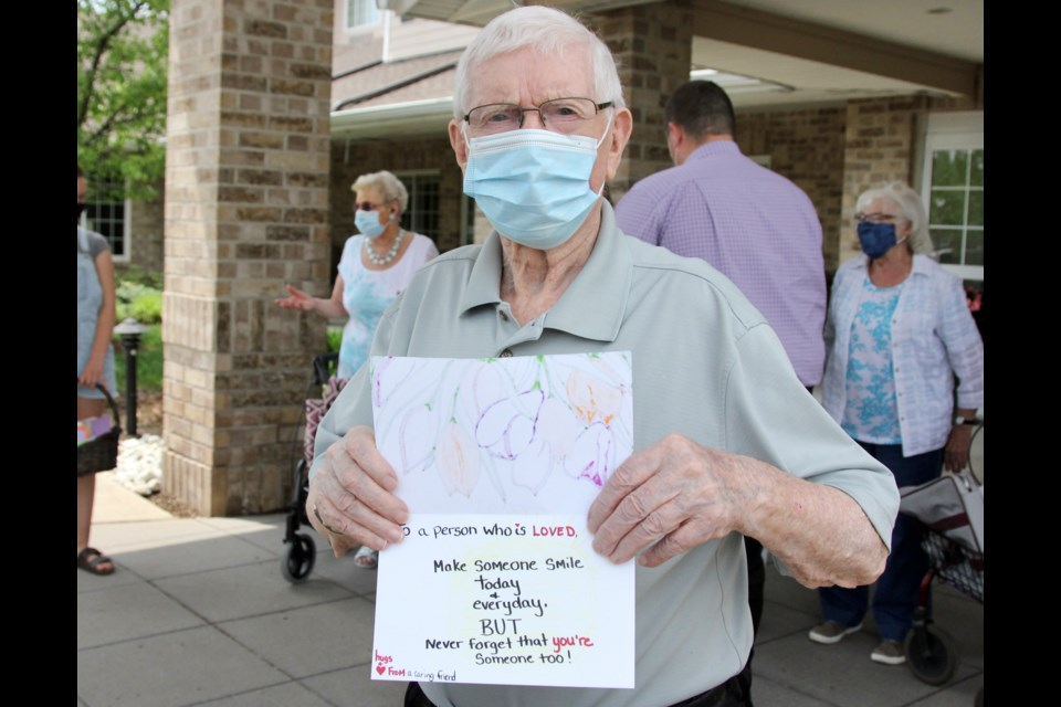 Resident David Wilson holds up his card given to him by Abigail Pastorius Tuesday. The card was through an initiative called Letters of Love launched by Abby at her school. Anam Khan/GuelphToday