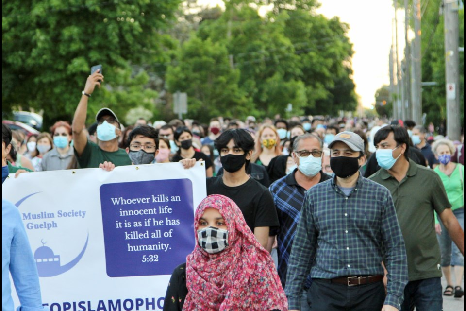 """Over 1,200 people attended the MSOG's vigil and march on Thursday to remember the lives lost in London on Monday and to speak out against Islamophobia. A man holds a verse from the Quran, """"Whoever kills an innocent life, it is as  if he has killed all of humanity."""" 5:32. Anam Khan/GuelphToday"""