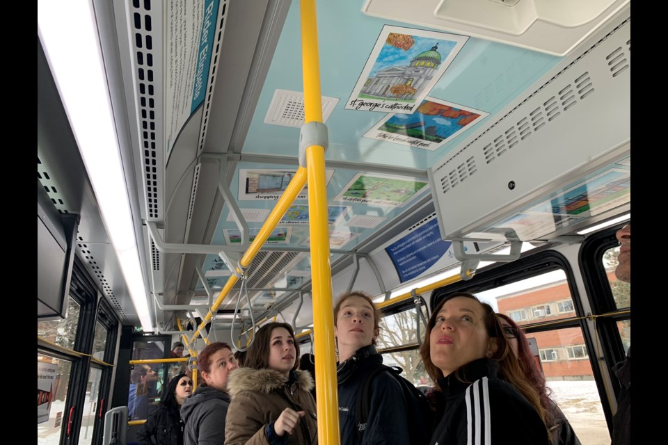 Students see artwork installed on a city transit bus. Supplied photo