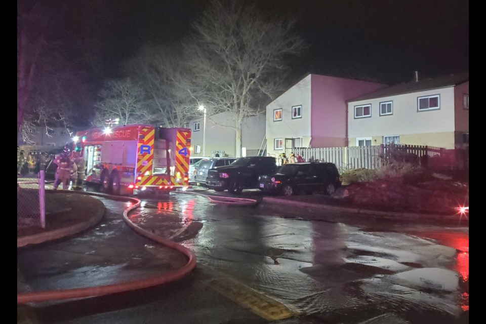 A woman was pronounced dead at the hospital in relation to this fire at a Westwood Road townhouse early Thursday morning. Photo by Keith Binding.