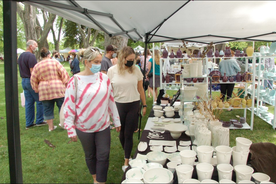 Marney Burnett, left, and her daughter Katie check out wares at the Guelph Potters' Market on Saturday.