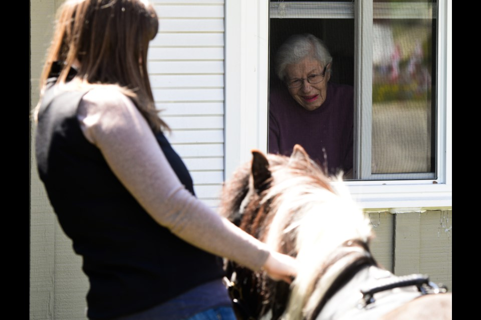 Helen Vanos and Gracie visit a resident of Stone Lodge Retirement Home on Wednesday. Tony Saxon/GuelphToday