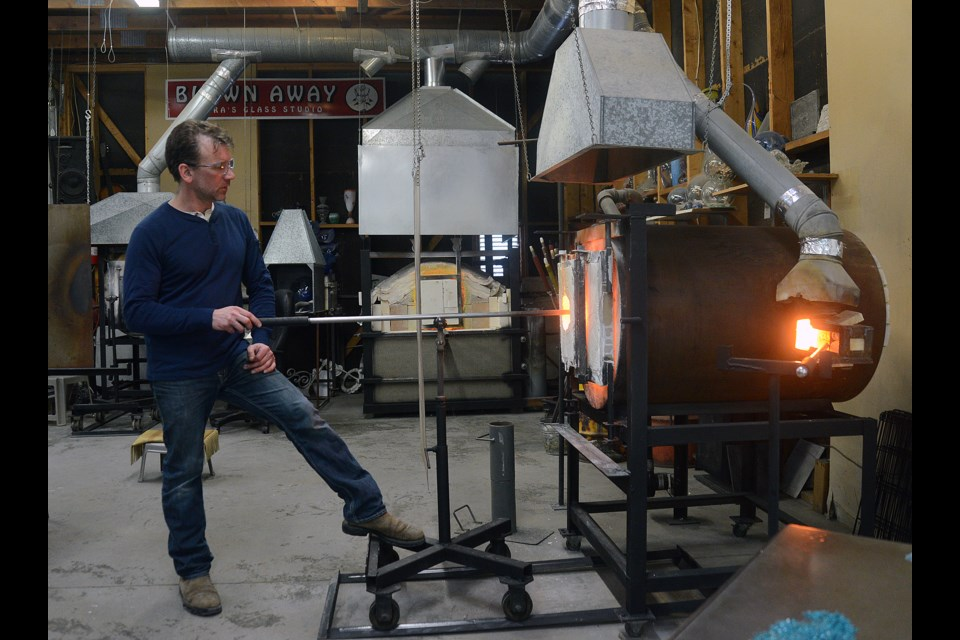 Tim McManus heats up some glass. Tony Saxon/GuelphToday