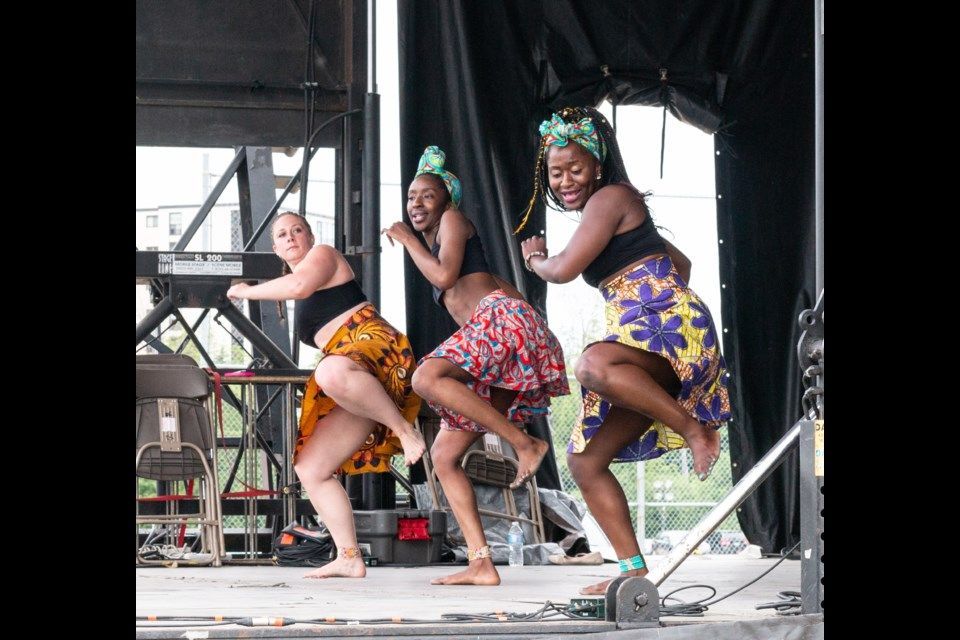 Caitlin Huiskcamp, Bintou Barrow and Binty Koroma of Afro-Tribal dance group perform during the Guelph Multicultural Festival. Photo by Olena Klahsen
