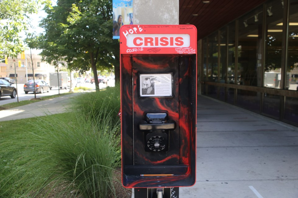 'Crisis Phone 2020' is an art installation intended to raise awareness about the opioid crisis in Guelph. It was created by artist and city councillor Mike Salisbury and will be on display outside the main library for about six months. Kenneth Armstrong/GuelphToday