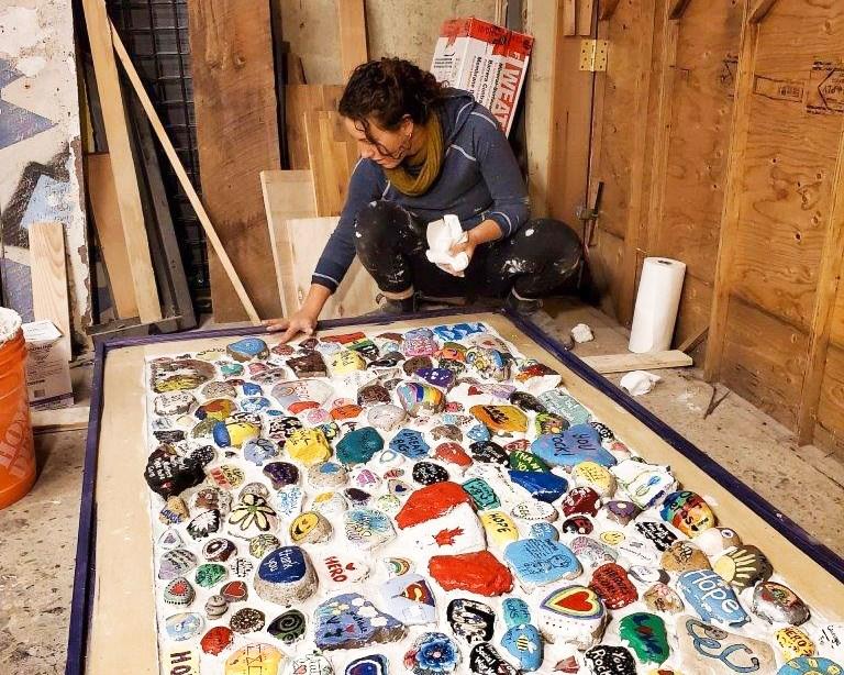 Artist Annie Burgess working on the mosaic. Supplied photo