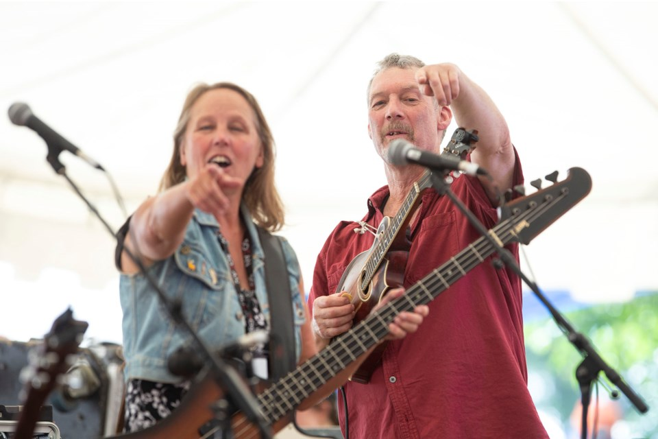 Molly Kurvink and Jeff Bird of Tamarack point to a member of the audience during a set with the band at Hillside Festival on July 7, 2018. Kenneth Armstrong/GuelphToday