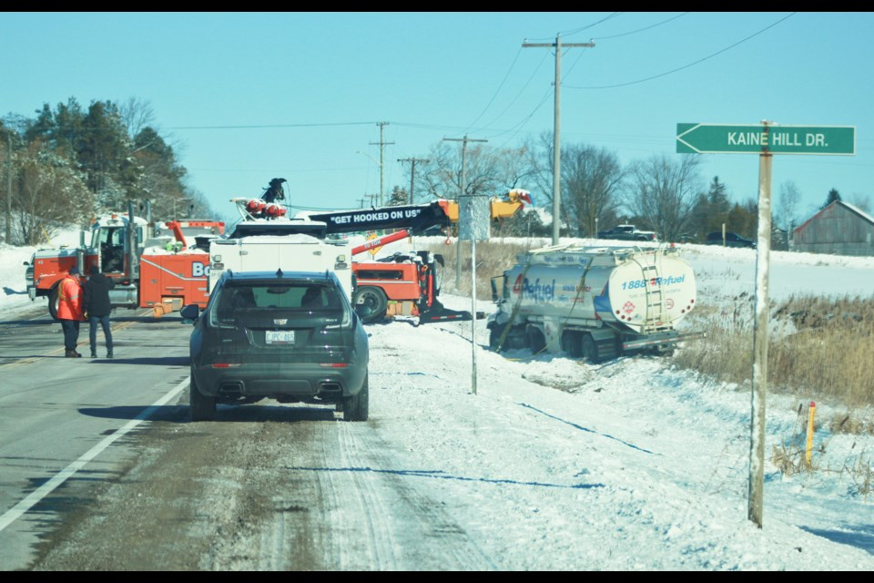 Crews work at pulling a fuel truck out of a ditch on County Road 124 just east of Guelph Monday morning. Tony Saxon/GuelphToday