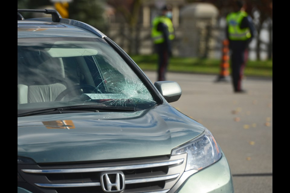 An SUV with a damaged windshield is parked near the scene of a serious collision Friday morning on Stone Road East. Tony Saxon/GuelphToday
