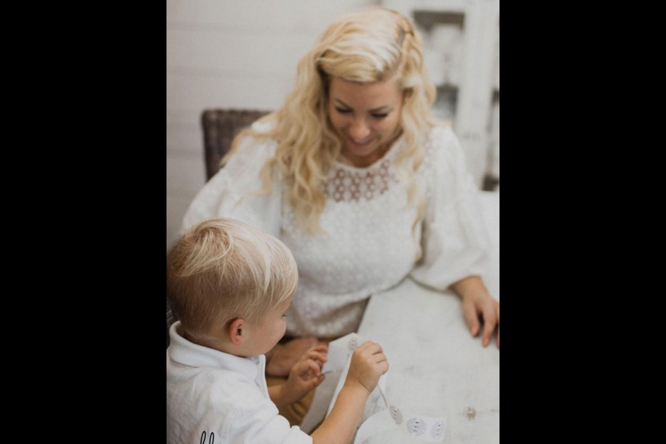 Kristy Miller and her son prepare some products. Supplied photo