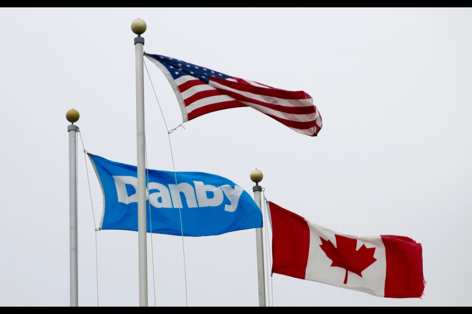 The Danby Products flag flies along side the Canadian and American flags at the company's Guelph headquarters. Rob O'Flanagan/GuelphToday
