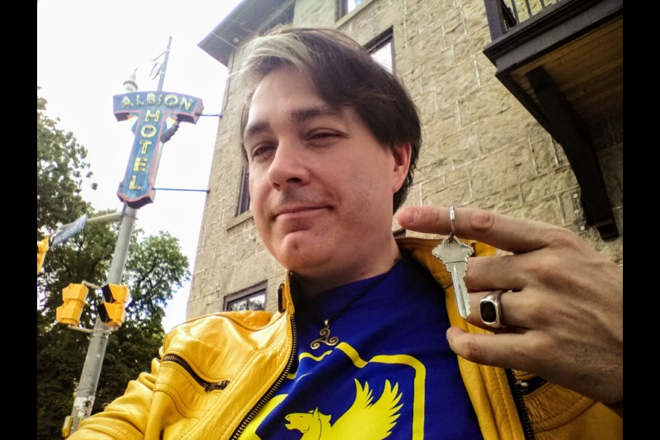 Thomas Gofton, the new owner of The Albion Hotel, takes a selfie after getting the key Friday. Supplied photo
