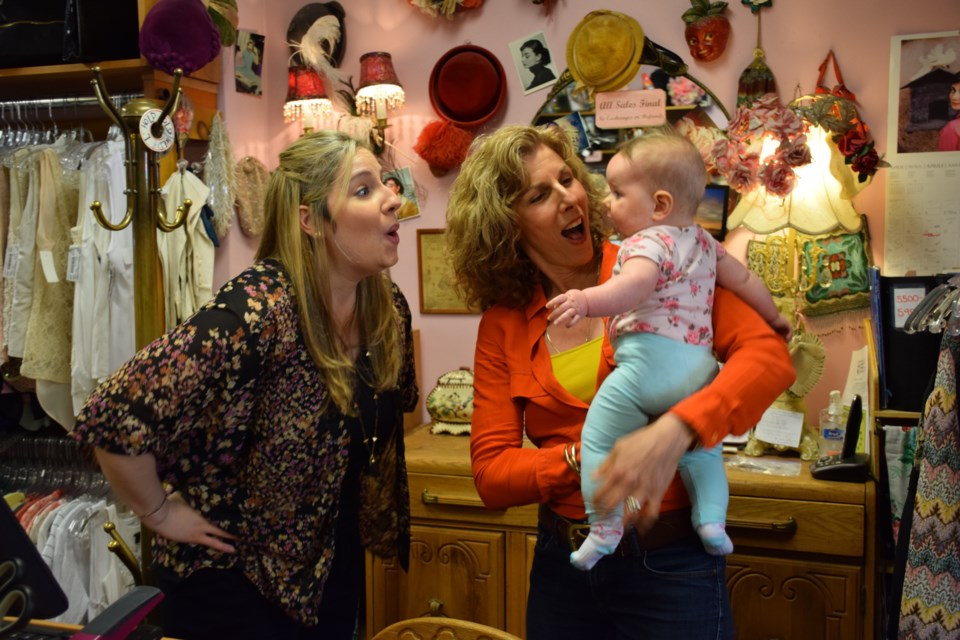 Owners Emily Vamplew, left, her baby Ella Rose, and Beth Cosentino, celebrating 25 years in business. Rob O'Flanagan/GuelphToday