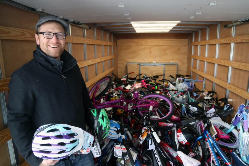 Dan Evans, neighbourhood development supervisor with Guelph Neighbourhood Support Coalition, stands in a cube van filled with bikes donated from Denso Manufacturing Canada, Inc. Kenneth Armstrong/GuelphToday