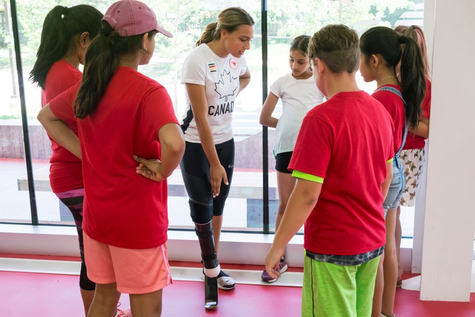 Kids listen as Paralympian Marissa Papaconstantinou talks about her running blade during the Jumpstart Games on Tuesday at the WF Mitchell Athletics Centre. Kenneth Armstrong/GuelphToday