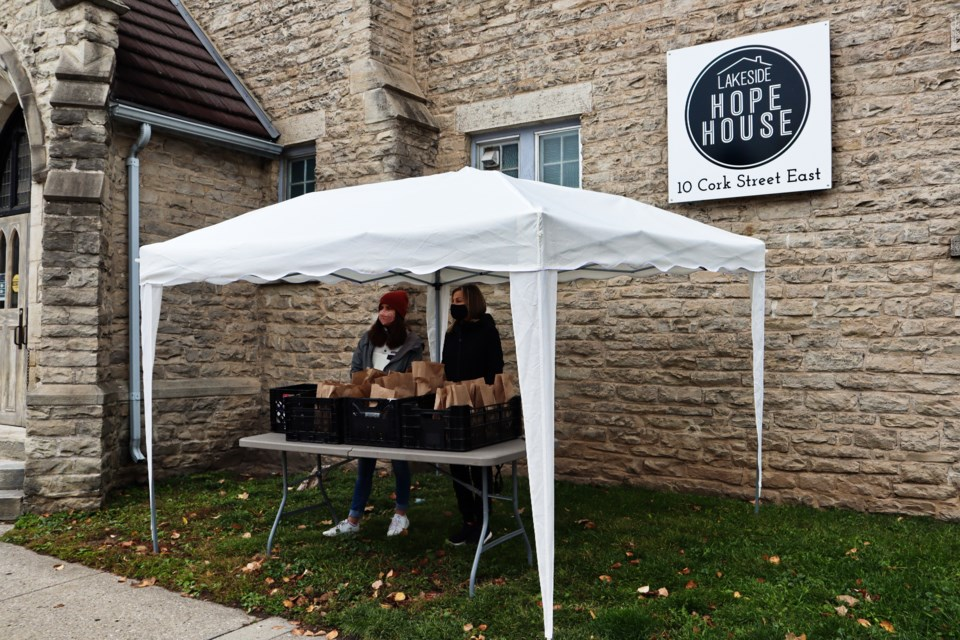 Two volunteers stand outside  HOPE House, waiting to serve residents. Ariel Deutschmann/GuelphToday
