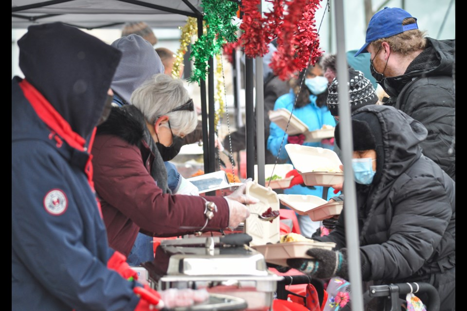 Serving up Christmas dinner on the street in Downtown Guelph on Christmas Day, a multi-pronged effort from several local organizations and volunteers. Tony Saxon/GuelphToday