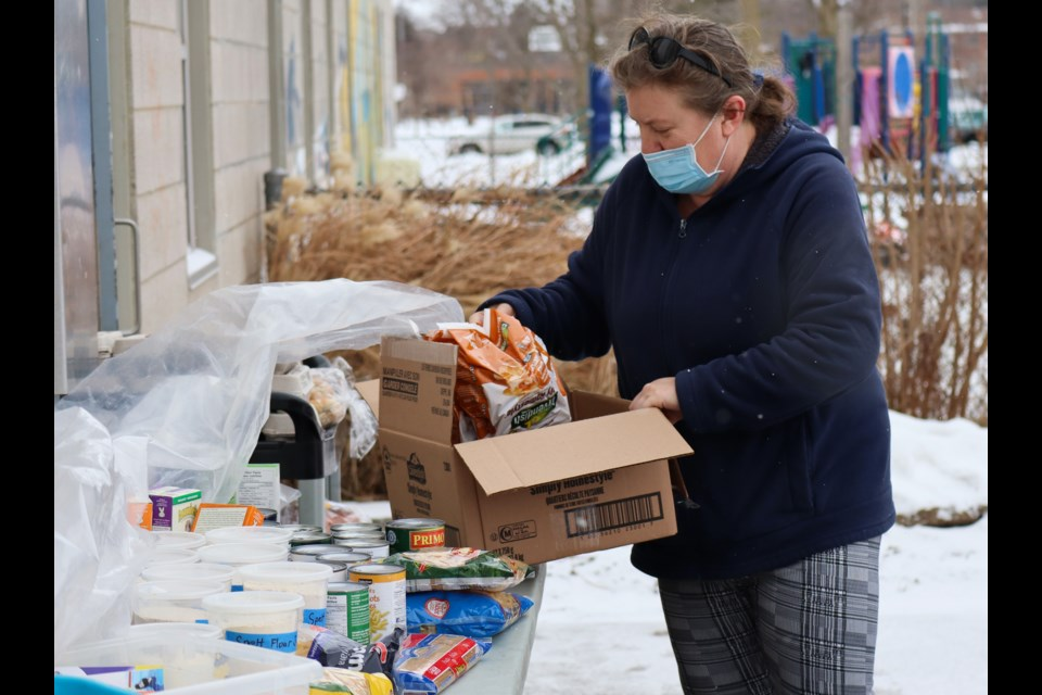 Shaver puts some more food items out on the table. Ariel Deutschmann/GuephToday