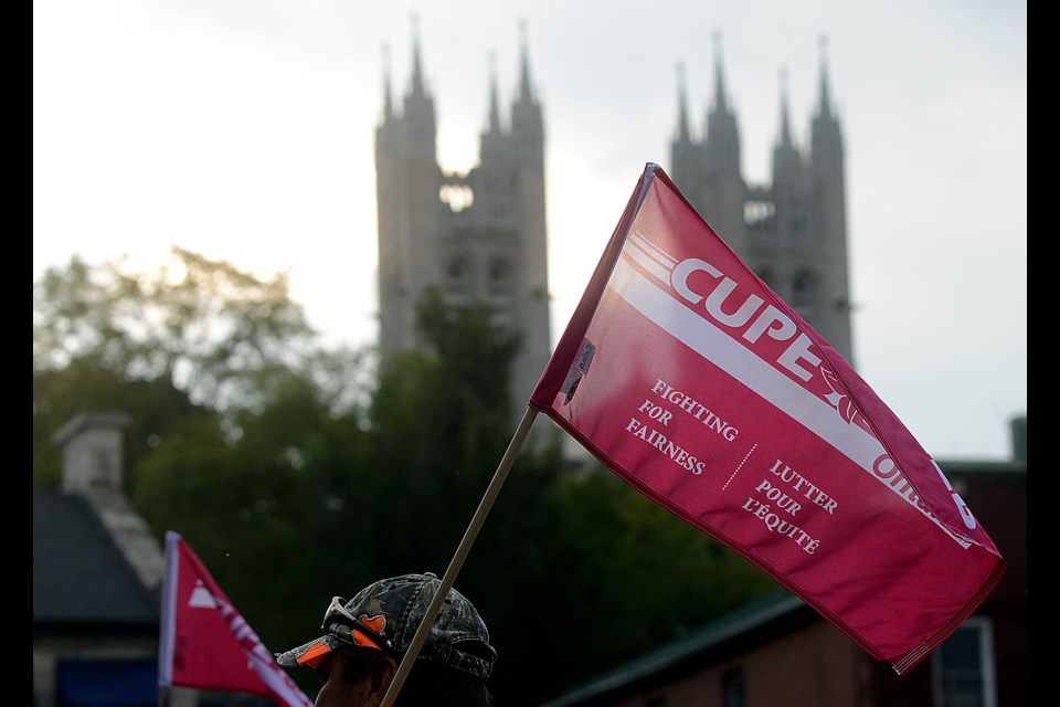 CUPE Local 241 rallied outside Guelph City Hall Monday, Sept. 18, 2017. The union fears the city is looking at privatizing waste resources in the city. Tony Saxon/GuelphToday.com